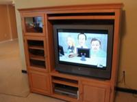 Beautiful light colored solid wood entertainment center