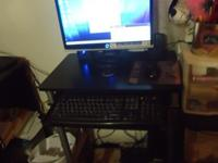 E-Machine Desktop and desk. It has a 19 inch flat