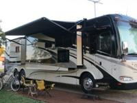 2011 Tuscany 42RQ, 4 slides, like new, loaded with