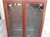 - $179--It has decorative trim at the top, 2 doors with