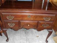 This is a nice heavy wood item, a wide top drawer, 3