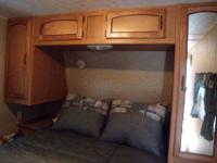 2011 PUMA 27 KFQ HAS A SIDE PAW KITCHEN WITH SINK, DORM