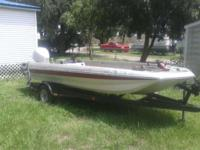 17ft Monark fiberglass bass boat with a 115 Johnson.