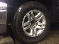 Nice clean Toyota rims . Tires have about 50% tread