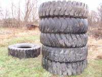 For sale: (6) tires and (5) rims. 18.00- 33 and 18.00 R