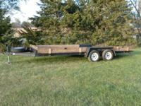 18 foot equipment or vehicle trailer in good condition,