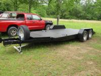 I HAVE FOR SALE AN 18 FOOT BLACK TRAILER- CAN HAUL