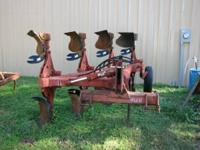 "(4) 18"" IH flip plow, ON LAND! with resettable shanks"