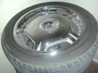 Selling 18 inch rims and tires. Also 4 universal lugs.