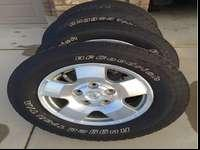 Tires and aluminum wheels off a 2013 Toyota Tundra TRD