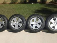 "JK Jeep factory rims and tires. Rims are 18 "" factory"