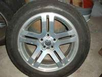 I have 4 rims from a Dodge Magnum. The bolt pattern is