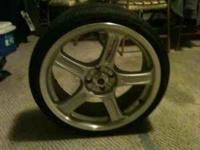 I have four chrome rims for sale along with four tires