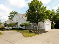 This enchanting Transitional showplace is nestled in an