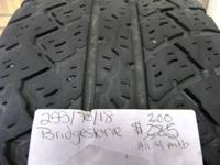 Four matched brand 255/70/18 used tires. Bridgestone.