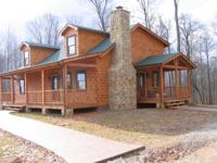 This is a beautiful log home with an adjoining 60 acre