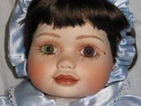 Olive May is a porcelain Marie Osmond doll from her