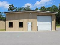 3000 sq/ft warehouse. Steel building with one 12 ft