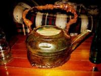 This copper kettle is uncommon and a piece of art in