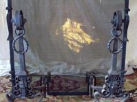 Large and heavy, hand wrought iron fireplace screen and