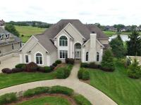 Upon entering this 5 bedroom, 5 bath custom built by