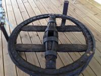 I have an Antique cart wheel for sale. Made in the mid