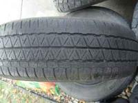 Set of four used 185-70-14 Dunlop all season tires.