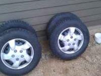 Set of four studded snow tires with rims that came off