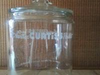 "This is a Curtiss Candy Co. Glass Jar. It has, ""Another"