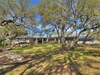 Nestled under a canopy of majestic Oaks not far from