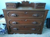 Hand sculpted of solid walnut around 1865 throughout