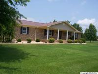 IMPECCABLY MAINTAINED BRICK RANCHER SITTING ON 23 ACRES