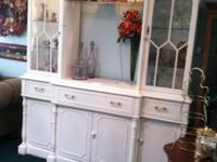 tall cabinet with enclosed and open shelves. also has