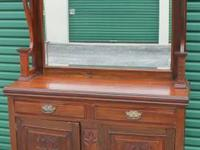 I have an antique walnut sideboard from the 1880s.