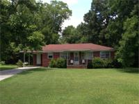 Picturesque 3 br, 1 ba brick home located on 2.5 +/- ac