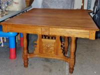 This is an attractive antique solid oak eating table