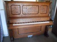 UPRIGHT PIANO MADE IN 1885 THE OUTSIDE IS IN GREAT