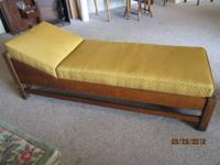 I have an early 1900's Mission Style Fainting sofa/day