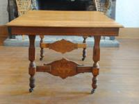 Antique strong quarter sawn oak table with 2 leaves.