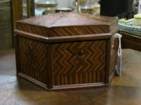 Marquetry, a method of inlaying intricate patters using