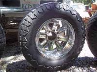 For sale. 4 Chrome 8 Spoke Rims and used tires. They