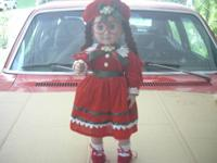 "this cute 18"" doll made  by Battat is  dressed in"