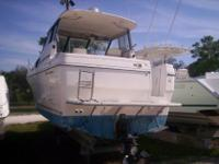 This 1995 Bayliner 2859 is equipped with a Mercruiser
