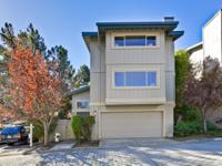 Stunning tri-level home with Bay View! Lovely deck off