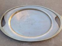 I am offering a really big nickel silver serving plate