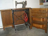 Very cool antique Sewing Machine in Oack Cabinet from
