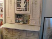 I have a beautiful Hoosier Kitchen Cabinet made in the