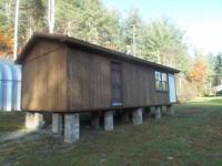 One bedroom one bath cabin for sale without appliances.