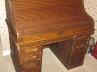 This is a full sized roll top desk from early in the