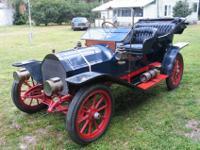 1909 Cadillac Model 30 Demi-Tonneau sport touring car.